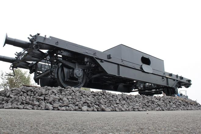 Wagon op spoor geplaatst